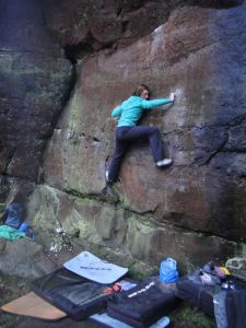 Gwen Lancashire on the immaculate Red Rocket (6c+) at the perma-ish-dry Wright's Rock in the Churnet Valley