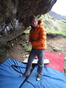 Calum Muskett avoiding the rain underneath Jerry's Roof in the Llanberis Pass