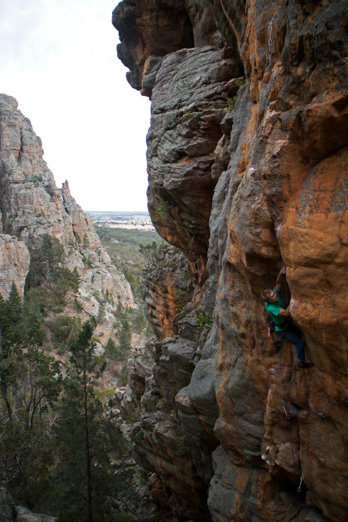 Ben on Mike Law's classic route Slopin Sleazin (28) on The Pharos, Arapiles.