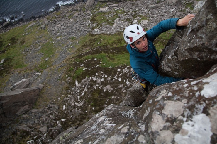 Henry Francis topping out of Jolly Roger (E3 6a). The 1000 yard stare coming from a blend of the extreme wind, long pitches, and poor nights sleep ;-)