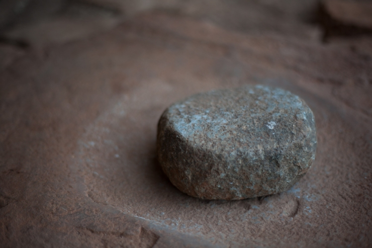 An ancient grinding stone, tactile and impressively smooth to touch